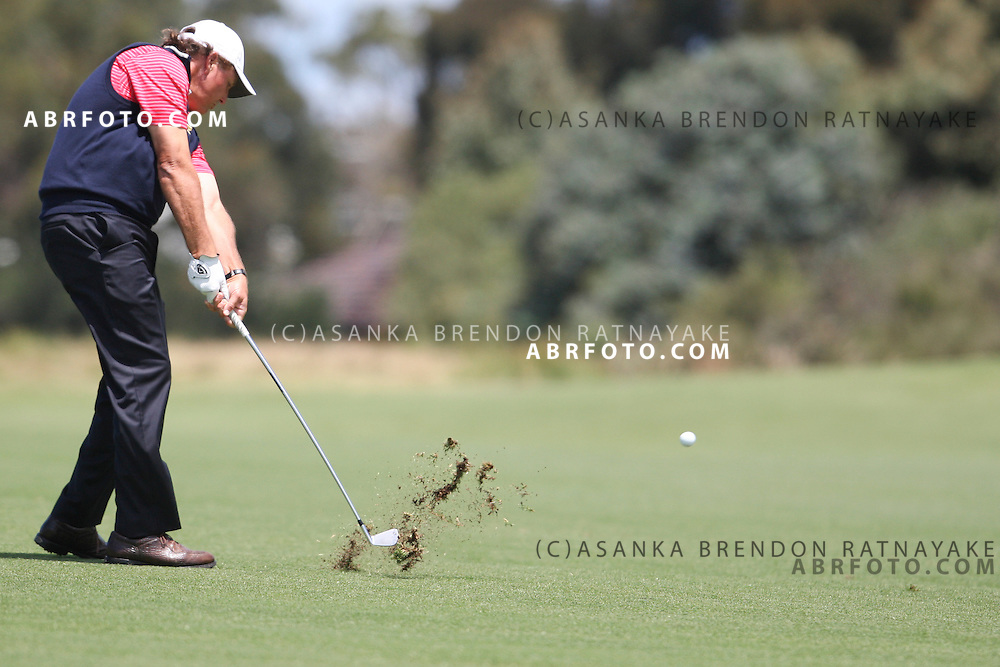 20 November 2011 : Phil Mickelson plays an iron shot during the fifth-round Sunday Final round single ball matches at the Presidents Cup at the Royal Melbourne Golf Club in Melbourne, Australia. .