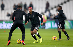 Fulham's Ryan Babel (centre) during the pre-match warm up prior to the beginning of the Premier League match at London Stadium.