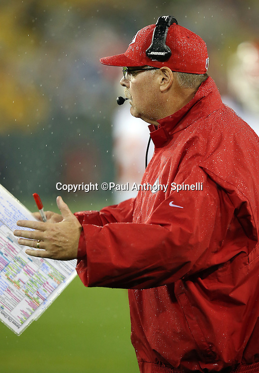 Kansas City Chiefs head coach Andy Reid waves his hands toward the field of play from the sideline during the 2015 NFL week 3 regular season football game against the Green Bay Packers on Monday, Sept. 28, 2015 in Green Bay, Wis. The Packers won the game 38-28. (©Paul Anthony Spinelli)