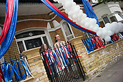 UNITED KINGDOM, London: 08 May 2020 <br /> Jane Lyde and her husband Toby, who run a balloon business, stand outside of their house for the two minute VE Day silence at 11:00 this morning. The couple have decorated their house with balloons and ribbons in celebration of the 75th anniversary of Victory in Europe Day (VE Day).
