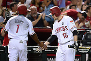 PHOENIX, AZ - JULY 04:  Michael Bourn #1 of the Arizona Diamondbacks is congratulated by Phil Gosselin #15 after scoring against the San Diego Padres during the fifth inning at Chase Field on July 4, 2016 in Phoenix, Arizona.  (Photo by Jennifer Stewart/Getty Images)