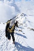 Climbers ascending ridge on Similaun Peak in the Alps on the Austria/Italy border.