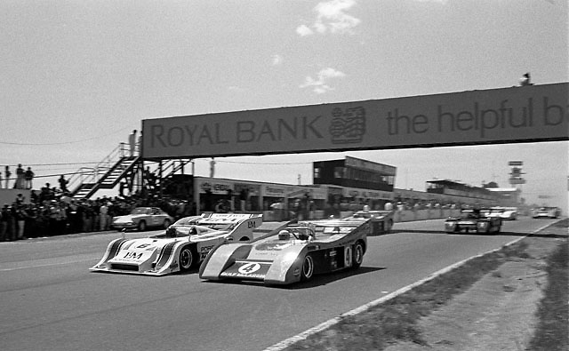 Mark Donohue in number 6 Porsche 917/10K starts from pole in its debut at the 1972 Mosport Can-Am, alongside 1971 Can-Am champion Peter Revson in no. 4 McLaren M20-Chevy; race winner Denny Hulme starts behind the Porsche in sister McLaren no. 5; black car is Shadow Mark III driven by Jackie Olvier