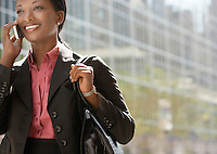 Businesswoman using mobile phone outdoors