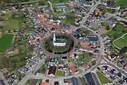 Nederland, Groningen, Gemeente Delfzijl, 01-05-2013; dorp Spijk, wierdedorp (wierde=terp). Beschermd dorpsgezicht met radiale structuur. Hervormde kerk (Andreaskerk) en Molen Ceres.<br /> Village on dwelling Mound, north-east Holland.<br /> luchtfoto (toeslag op standard tarieven);<br /> aerial photo (additional fee required);<br /> copyright foto/photo Siebe Swart