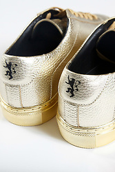 September 1, 2017 - inconnu - Game of Thrones fans can walk in the footsteps of one their heroes – with a pair of specially designed sneakers.The limited edition gold shoes from New York based KOIO Collective is a tribute to one-handed Jaime Lannister , known as Kingslayer.The collaboration with Game of Throne's maker , US TV studio HBO , features an ornamental lace tab called a deubré in the shape of Jaime Lannister's gold hand. The Lannister family crest of a lion rampant is also stamped on the heel.The Kingslayer is printed on the inside soles.The shoe is based on Koio's signature Capri sneaker.It is made with Italian leather. Koio has made just 150 pairs but they will not be available for sale.Instead the company plans to give them out as prizes of an Instagram competition to some lucky fans.All contestants have to do is report a photo of the shoes ion Instgram along with their shoe size. # BASKETS GAME OF THRONES (Credit Image: © Visual via ZUMA Press)