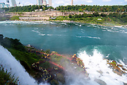 Tourists soak in the mist of Bridal Veil Falls, a part of the greater Niagara Falls area, Buffalo, New York, USA.