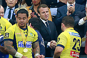 French president Emmanuel Macron shakes hands with a player during the French Top 14 rugby union final match between RC Toulon and ASM Clermont-Ferrand on June 4, 2017 at the Stade de France in Saint-Denis.