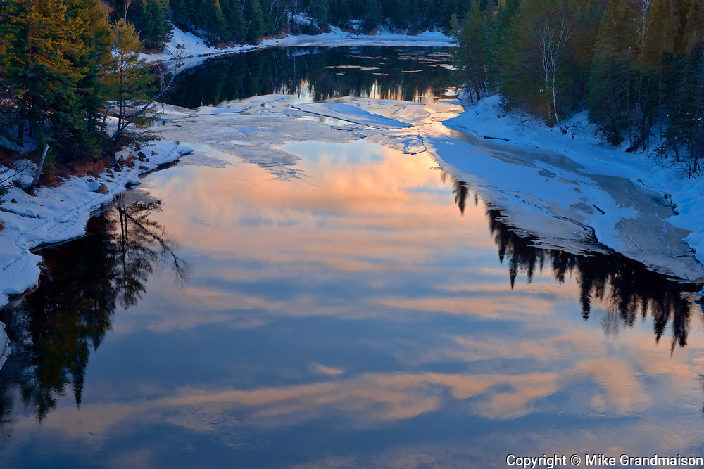Reflection of clouds at sunrise in the Seine River<br />