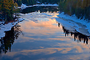 Reflection of clouds at sunrise in the Seine River<br /><br />Ontario<br />Canada