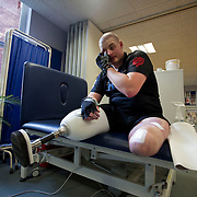 Pte Stephen Bainbridge of the Black Watch (3SCOTS) who lost both legs in an IED explosion on the 11th of November 2011 in Loya Manda, Helmand Province, Afghanistan is now recovering well. Stephen rubs the tiredness from his eyes as the physical strain of the rehabilitation takes it toll Headley Court RAF Hospital, England on the 20th of March 2012.