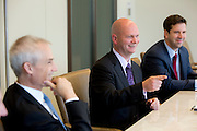 Dave Wilson (center), gives remarks during an interview at Nuveen Asset Management in downtown Chicago, Ill., on Wednesday, September 23, 201