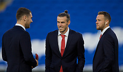 CARDIFF, WALES - Sunday, October 13, 2019: Wales' captain Gareth Bale (C) with Sam Vokes (L) and Chris Gunter (R) wearing suits on the pitch before the UEFA Euro 2020 Qualifying Group E match between Wales and Croatia at the Cardiff City Stadium. (Pic by Paul Greenwood/Propaganda)