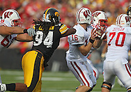 October 23 2010: Iowa Hawkeyes defensive end Adrian Clayborn (94) comes around the end to strip the ball from Wisconsin Badgers quarterback Scott Tolzien (16) during the first half of the NCAA football game between the Wisconsin Badgers and the Iowa Hawkeyes at Kinnick Stadium in Iowa City, Iowa on Saturday October 23, 2010. Wisconsin defeated Iowa 31-30.