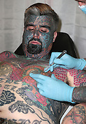 "EXCLUSIVE<br /> Britain's most tattooed man ""King Of Ink Land"" has had is nipple removed in this latest bizarre twist King of ink as he is now known<br /> spent friday morning having his nipple removed,<br /> <br /> King of ink said ""I have never really found my nipples attractive. In fact I just didn't like them. My girlfriend will miss them as she use to enjoy biting them something that comes a little bit erotica, However I am pleased to finally have them removed. It was not in the least painful however the next week or two I will be a,little sore.<br /> <br /> he went to say<br /> <br /> We will always respect our bodies.<br /> <br /> We believe it is our right to explore our world, both physical and supernatural, through spiritual body modification.<br /> <br /> We promise to always grow as individuals through body modification and what it can teach us about who we are and what we can do.<br /> <br /> We vow to share our experiences openly and honestly in order to promote growth in mind, body, and soul.<br /> <br /> We honor all forms of body modification and those who choose to practice in safe and consensual ways.<br /> <br /> We also promise to respect those who do not choose body modification.<br /> <br /> We support all that join us in our mission and help those seeking us in need of spiritual guidance.<br /> <br /> We strive to share a positive message with everyone we encounter, in order to act as positive role models for future generations in the body modification community.<br /> <br /> We always uphold basic codes of ethics and encourage others to do the same.<br /> when asked about his latest body transformation he replied <br /> <br /> ""I may practice rituals and body modification without prejudice or discrimination. By acting responsibly and with integrity, I wish to observe our sincerely held religious beliefs without restriction""<br /> ©Exclusivepix"