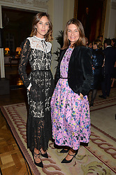 Left to right, ALEXA CHUNG and NATALIE MASSENET at a party to kick off London Fashion Week hosted by US Ambassador Matthew Barzun and Mrs Brooke Brown Barzun with Alexandra Shulman in association with J.Crew hrld at Winfield House, Regent's Park, London on 18th September 2015.