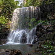 The Pha Takien waterfall in the forests of the Pang Sida National Park, a world heritage site, in Thailand. The falls are hidden in the forest and only flow during the rainy season between September and December.