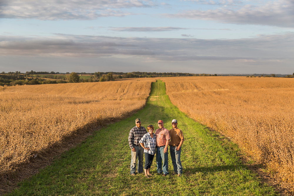(From left) Tyler, Leanne, Kenny and Jacob Sutter pose in the grass buffer strip in one of the family's soybean fields near Pleasantville, Iowa, on October 6, 2015. Photo by Ryan Donnell