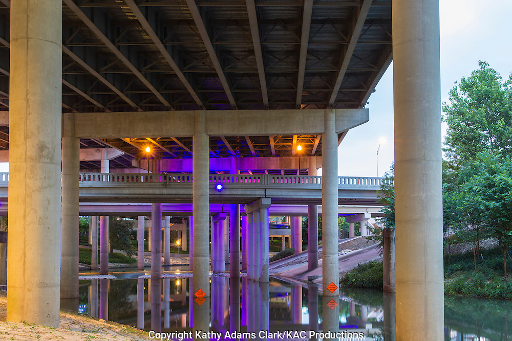 Reflections of Interstate 45 in Buffalo Bayou in downtown Houston, Texas.