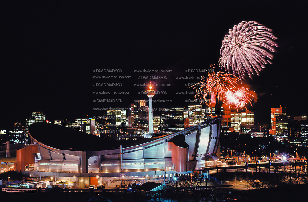CALGARY, CANADA - FEBRUARY 1988:  A general view of downtown Calgary, including the Saddle Dome in the foreground and fireworks, during the XV Winter Olympic Games held February 13-28, 1988 in Calgary, Canada.  (Photo by David Madison/Getty Images)
