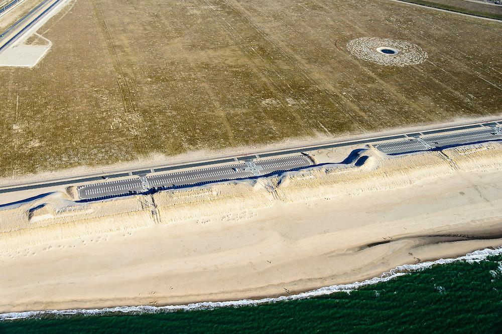 Nederland, Zuid-Holland, Rotterdam, 18-02-2015; Tweede Maasvlakte, het nieuwe badstrand met parkeerterrein en duinovergangen <br /> Maasvlakte 2 (MV2), extension of the Port of Rotterdam, in the foreground the new bathing beach with parking and dune crossings.<br /> luchtfoto (toeslag op standard tarieven);<br /> aerial photo (additional fee required);<br /> copyright foto/photo Siebe Swart