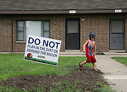 Joshua Foreman, 3, plays at his home at the West Calumet Housing Complex in East Chicago.