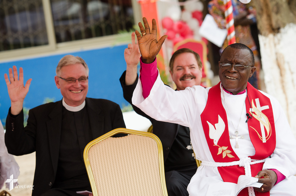 (L-R) Professor Timothy Quill, the Rev. Dr. George Black, and the ELCG Rt. Rev. Dr. Paul Kofi Fynn raise their hands in agreement after LCMS President Rev. Dr . Matthew C. Harrison asked everyone if they were sinners during his sermon at the service and dedication of the Lutheran Theological Seminary of the Evangelical Lutheran Church of Ghana on Sunday, Feb. 2, 2014, in Greater Accra, Ghana. LCMS Communications/Erik M. Lunsford