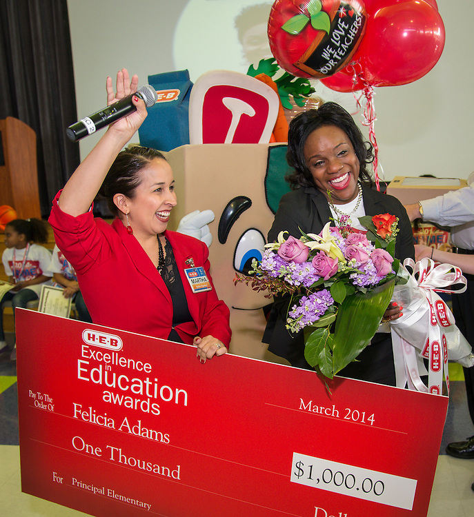 Lockhart Elementary School principal Felicia Adams, right, reacts after being named a finalist in the HEB Excellence in Education Awards, April 4, 2014.
