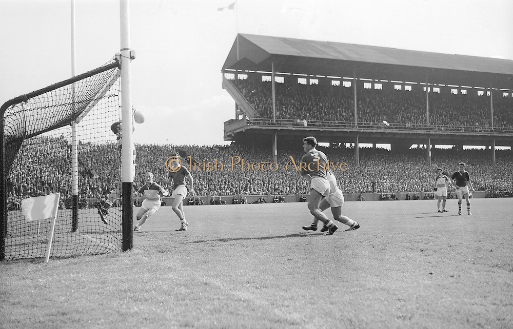GAA All Ireland Minor Football final Cork V. Offaly 27th September 1964 at Croke Park..Cork Goalie clears with E. Kennedy (13) Offaly and S.Cawley (3) Cork also in picture ..27.9.1964  27th September 1964