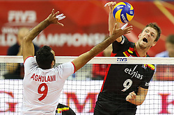 06.09.2014, Krakow Arena, Krakau, POL, FIVT WM, Belgien vs Iran, Gruppe D, im Bild Pieter Verhees (BEL), Adel Gholami (IRI) // during the FIVB Volleyball Men's World Championships Pool D Match beween Belgium and Iran at the Krakow Arena in Krakau, Poland on 2014/09/06.<br />