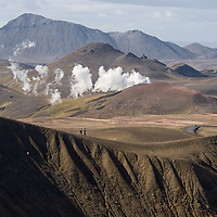 ...the same tourists walking along the Stóra-Víti crater's rim. The steam emanate from the Kröflustöð geothermal power station.