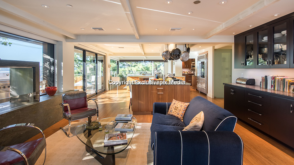 """EXCLUSIVE - Jane Fonda home – splits with boyfriend and home - mansion on the market for US$13 million<br /> <br /> OFFICIALLY AUTHORIZED HIGHRES PHOTOS <br /> <br /> It was love at first sight, twice. The first, when actress Jane Fonda met music producer Richard Perry while in hospital recovering from knee surgery in 2009. The second, when the couple took a look at this modernist mansion in Beverly Hills a few years later.<br /> <br /> She knew immediately it was the house for her and her partner, but now, five years later, after their break-up was announced on Monday [Jan 24, 2017], it is time to say goodbye to the 660 sq.m home.<br /> <br /> """"I took one look at this house and I knew, I just knew,"""" recalls Fonda, """"This was a place where we could live very happily.""""<br /> <br /> She was attracted to the strong architectural lines, the shining stainless steel front door, and the many windows with their stunning canyon and views. <br /> <br /> """"The house inspires me to be comfortable and have a great time,"""" she says, happily recalling celebrating her 75th birthday with 150 guests in the home.<br /> <br /> The two-story, four bedroom home was built in 1961 but has been remodelled with a number of environmentally friendly features: bamboo floors, solar heating, bio-ethanol fireplaces and thermal glass double-glazed UV windows.<br /> <br /> But just an enticing to the 79-year-old environmentalist was the master bedroom with its dual master baths and walk-in closets. """"This is the first time in my 79 years that I have had a closet that you could walk in and see everything that you have,"""" she says.<br /> <br /> Other features in the home include a glass lift, a media room and a gym.<br /> <br /> Outdoors, and spread over 1/3 hectare, the property features a solar heated pool, a deck extending over the steep hillside, a secluded meditation garden with a fountain, and a fire pit """"where you can see the sun set.""""<br /> <br /> The ex-couple decorated their home with the trappin"""