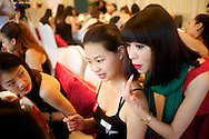 Isabel Cao(R), a training director, teaches proper make up application to conontestants for the Miss Universe China Pageant  at a training camp for contestants in Beijing, China on Thursday, June 23, 2011.   The training camp was created by cosmetics businesswoman and Chinese-American television personality Yue-Sai Kan's to give China, which has never won a Ms. Universe Contest, a cpotential contender in the upcoming beauty pagent.