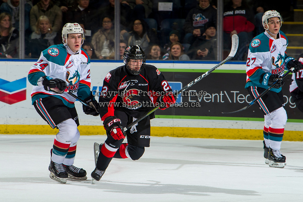 KELOWNA, CANADA - JANUARY 4: Craig Armstrong #22 of the Prince George Cougars is back checked by Kyle Topping #24 of the Kelowna Rockets  on January 4, 2019 at Prospera Place in Kelowna, British Columbia, Canada.  (Photo by Marissa Baecker/Shoot the Breeze)
