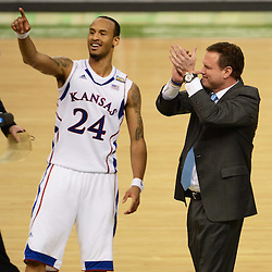 Mar 31, 2012; New Orleans, LA, USA; Kansas Jayhawks head coach Bill Self (right) and guard Travis Releford (24) celebrate after defeating the Ohio State Buckeyes 64-62 in the semifinals of the 2012 NCAA men's basketball Final Four at the Mercedes-Benz Superdome. Mandatory Credit: Derick E. Hingle-US PRESSWIRE