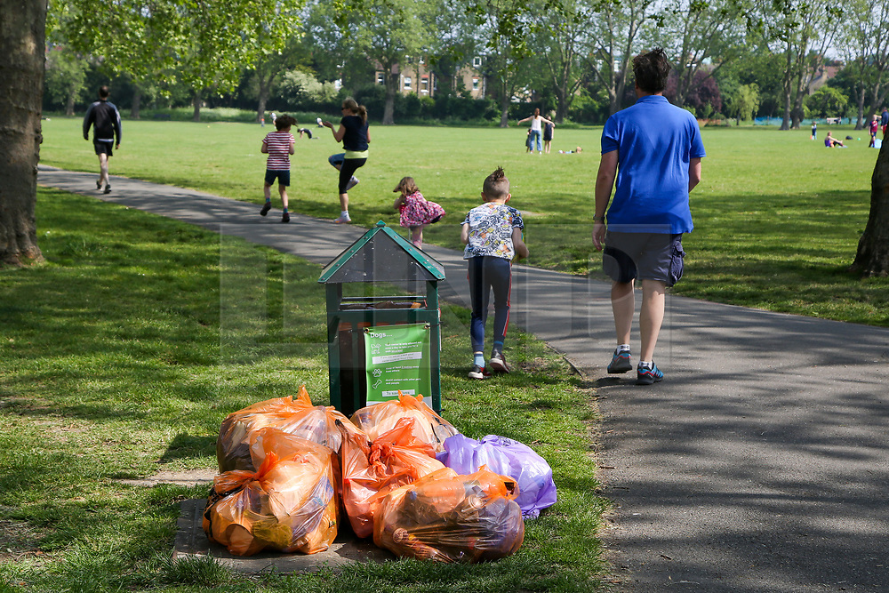 © Licensed to London News Pictures. 10/05/2020. London, UK. Bags of rubbish in a park in Haringey, north London after members of the public enjoyed the hottest day of the year so far, during the coronavirus lockdown on Saturday 9 May. Later today, Prime Minister Boris Johnson is set to announce measures to ease the lockdown, which was introduced on 23 March to slow the spread of the COVID-19. Photo credit: Dinendra Haria/LNP
