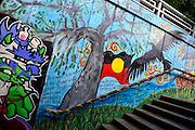 Public mural depicting Aboriginal heritage and Australian Aboriginal Flag. Saint Kilda, Melbourne, Australia