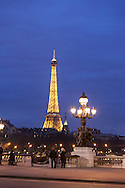 France. Paris. Pont Alexandre III bridge and eiffel tower on Seine River. Before to publish an image of the Eiffel tower lighting you should contact SETE; Mr Dieu at +33144112399 particularly for advertinsing.