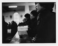 Han woman sings a hymn during service at St. Yage Episcopal Church, Yichang, Hubei, China.