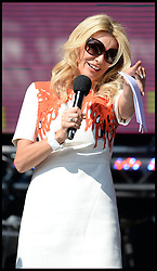 Tess Daly on stage at the  Celebration of the 2012 Olympic Games volunteering one year on at the  Queen Elizabeth Olympic Park.<br /> Mayor of London Boris Johnson and Lord Coe will be taking to the stage at Go Local to encourage a new drive in volunteering one year on from the Games. Also present are multi-platinum selling pop rock band McFly; world famous comedian Eddie Izzard, Brit Award nominated The Feeling, and Britain'Got Talent winners Attraction, in addition to stars Jack Carroll and Gabz. The event will be the UKs biggest ever celebration of volunteering and first Olympic and Paralympic legacy event at Queen Elizabeth Olympic Park.<br /> London, United Kingdom<br /> Friday, 19th July 2013<br /> Picture by Andrew Parsons / i-Images