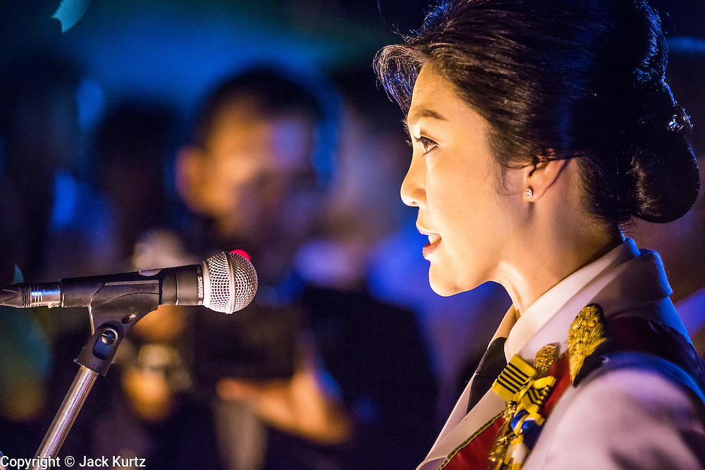 05 DECEMBER 2013 - BANGKOK, THAILAND: YINGLUCK SHINAWATRA, the Prime Minister of Thailand, reads a proclamation honoring the King at the celebration of the birthday of the King in Bangkok. Thais observed the 86th birthday of Bhumibol Adulyadej, the King of Thailand, their revered King on Thursday. They held candlelight services throughout the country. The political protests that have gripped Bangkok were on hold for the day, although protestors did hold their own observances of the holiday. Thousands of people attended the government celebration of the day on Sanam Luang, the large public space next to the Grand Palace in Bangkok.     PHOTO BY JACK KURTZ
