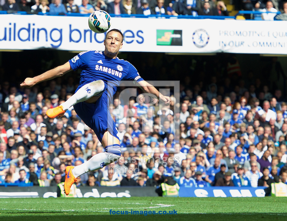 John Terry of Chelsea kicks the ball clear during the Barclays Premier League match at Stamford Bridge, London<br /> Picture by Alan Stanford/Focus Images Ltd +44 7915 056117<br /> 03/05/2015