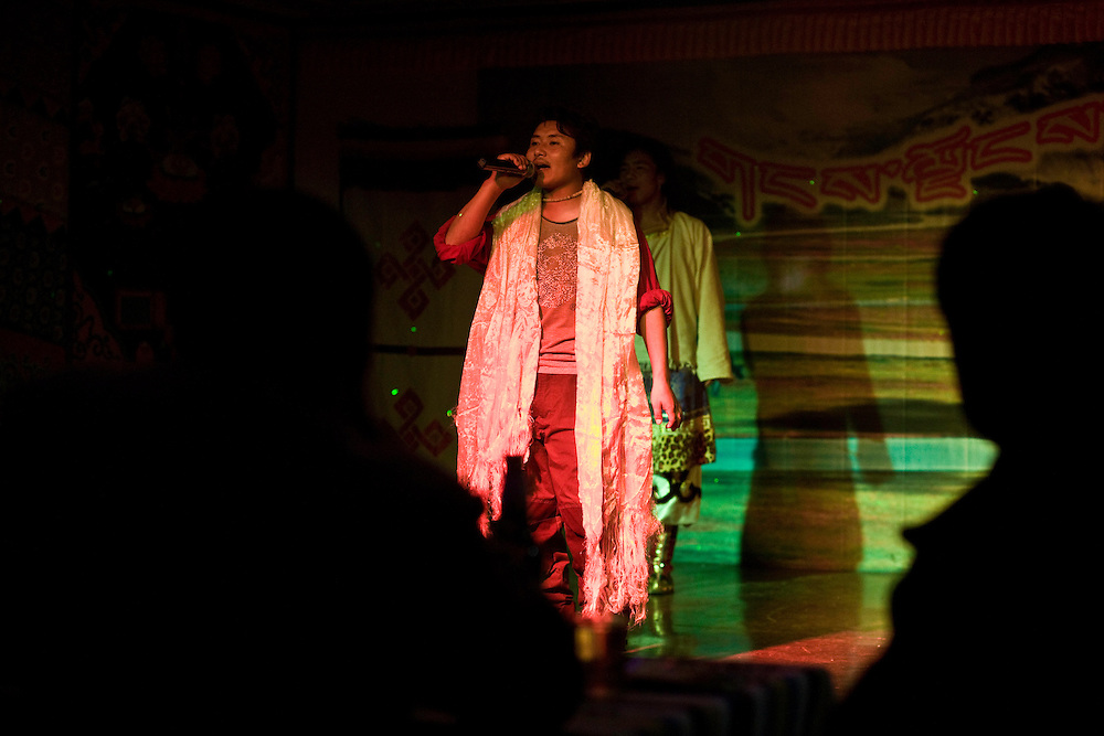 A tibetan singer in a new nightclub of Xiahe (Gansu province). The lyrics speek about love and liberty in the grasslands.