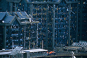 Gathered on the Docklands Light Railway track, a group of police investigators and health and safety experts stand beneath the devastation and wreckage caused by the IRA's docklands bomb on 10th February 1996. Office windows have been blown out and shattered glass lies everywhere making these workplaces unusable for many months afterwards. We see the men under the tall buildings looking tiny in comparison to the chaotic aftermath of this enormous explosion the day before. The bombing marked the end of a 17-month IRA ceasefire during which Irish, British and American leaders worked for a political solution to the troubles in Northern Ireland. 2 people were killed in the half-tonne lorry bomb blast which caused an estimated £85 million damage.