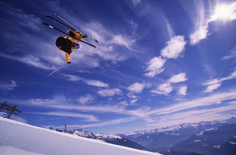 Sport. Male skier jumping out of a half pipe, Laxx, Switzerland