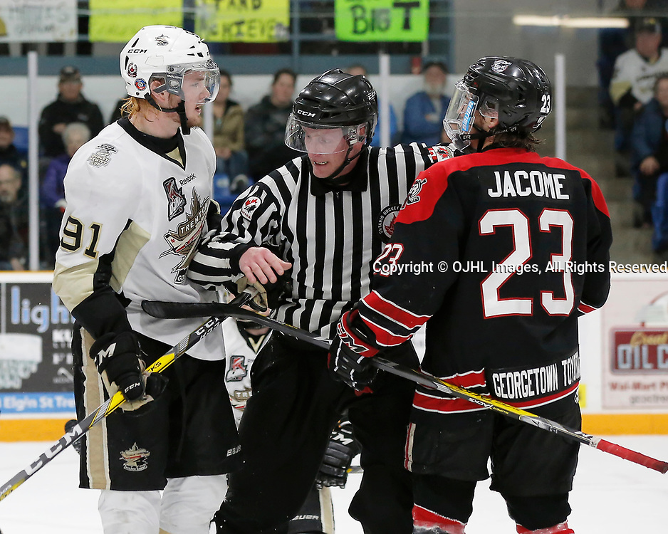 TRENTON, ON - APR 15,  2017: Ontario Junior Hockey League, Championship Series. Georgetown Raiders vs the Trenton Golden Hawks in Game 2 of the Buckland Cup Final. OHA Linesman Gray during words between Mac Lewis #91 of the Trenton Golden Hawks and Jack Jacome #23 of the Georgetown Raiders during the second period<br /> (Photo by Amy Deroche / OJHL Images)