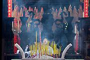 Cholon (Chinatown). Thien Hau Pagoda. Worshippers burning inscense.