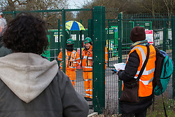 Harefield, UK. 17 January, 2020. HS2 security guards film and observe activists from Stop HS2 and Extinction Rebellion beginning a three-day 'Stand for the Trees' protest in the Colne Valley. The event has been timed to coincide with tree felling work by HS2 adjacent to the site of Stop HS2's Colne Valley wildlife protection camp. Bailiffs acting for HS2 have been evicting Stop HS2 activists from the camp for the past week and a half. 108 ancient woodlands are set to be destroyed by the high-speed rail link.