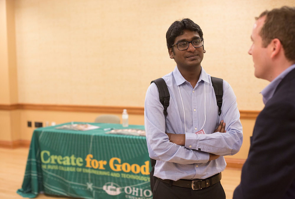 Nitin Shitole, a student at Wayne State University, left, and Scott Waters, a representative with UPS, talk about work opportunities at the Institute of Industrial and Systems Engineering Regional Conference in Baker Center on Feb. 25, 2017.