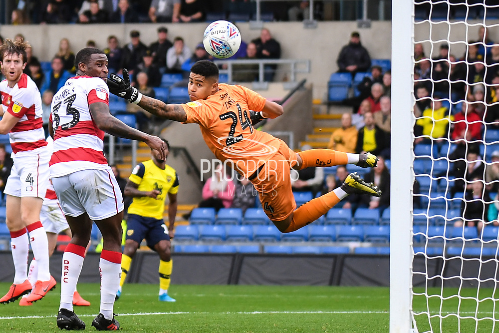 Doncaster Rovers goalkeeper (on loan from QPR) Seny Dieng (24) makes an important save during the EFL Sky Bet League 1 match between Oxford United and Doncaster Rovers at the Kassam Stadium, Oxford, England on 12 October 2019.
